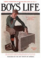 Boy on Trunk from the October 1913 Boys' Life cover